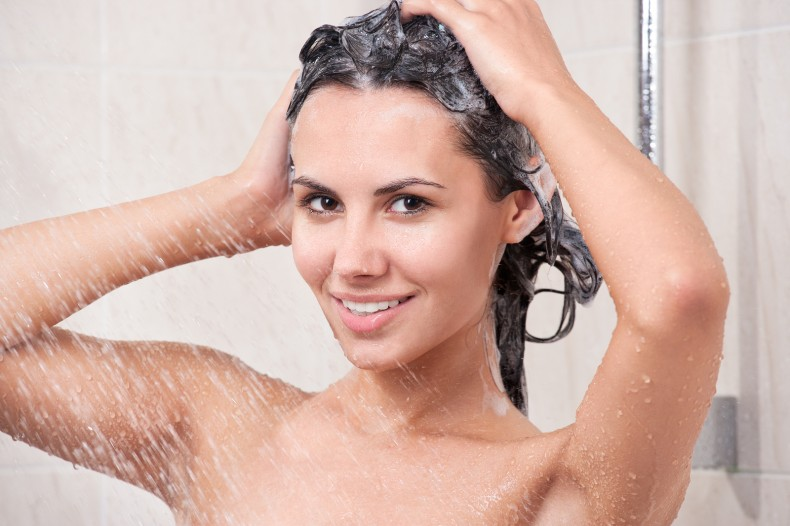 bigstock-Young-woman-washing-head-by-s-37586176