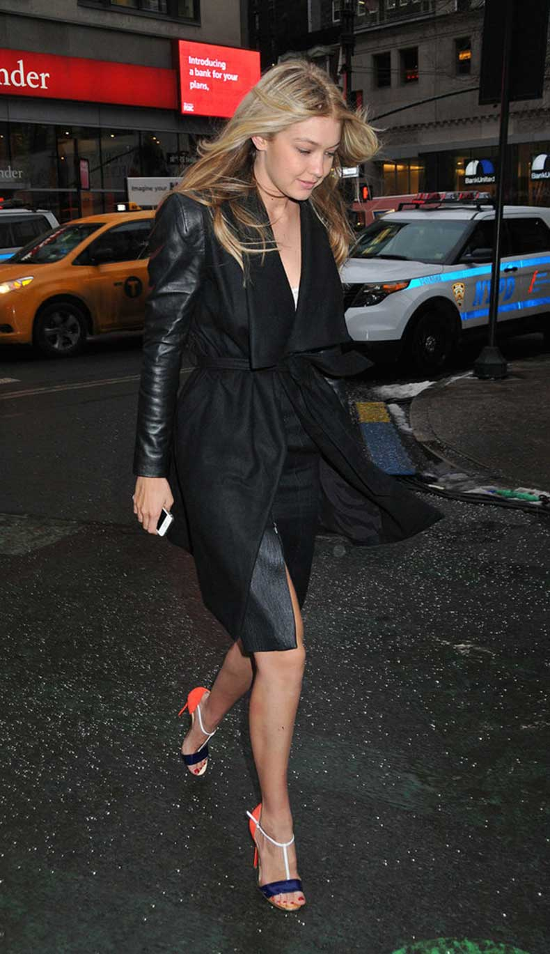 She-showed-off-her-stems-slick-pencil-skirt-belted-coat