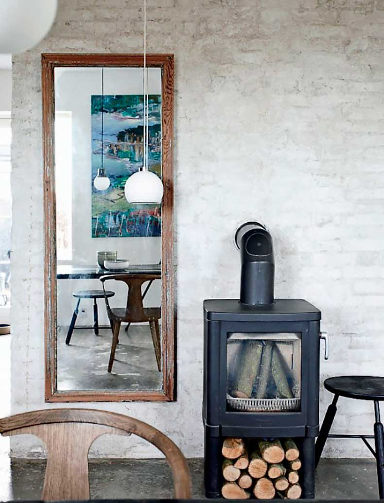 Dining-Room-in-Denmark-Apartment-with-Wood-Fired-Stove,-Remodelista