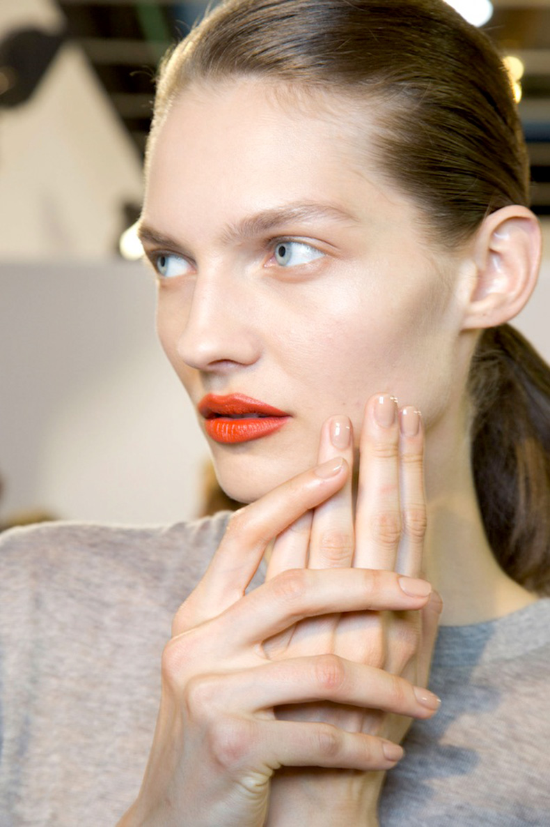 Le-Fashion-Blog-Spring-Beauty-Orange-Lipstick-Nude-Nails-Nail-Polish-Grey-Sweater-Ponytail-Acne-FW-2015-Backstage